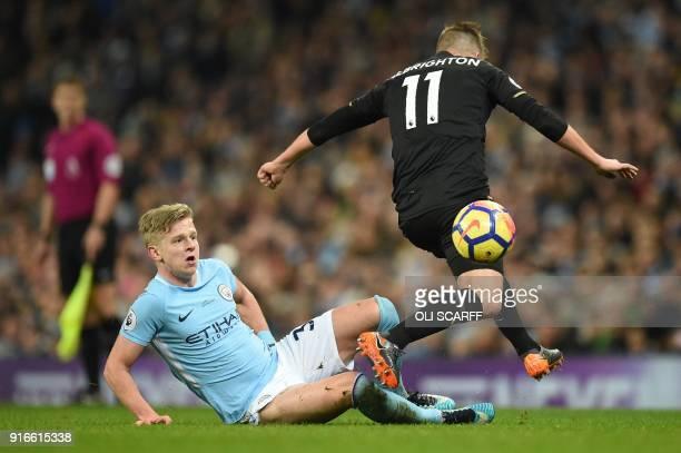 Manchester City's Ukrainian midfielder Oleksandr Zinchenko vies with Leicester City's English midfielder Marc Albrighton during the English Premier...