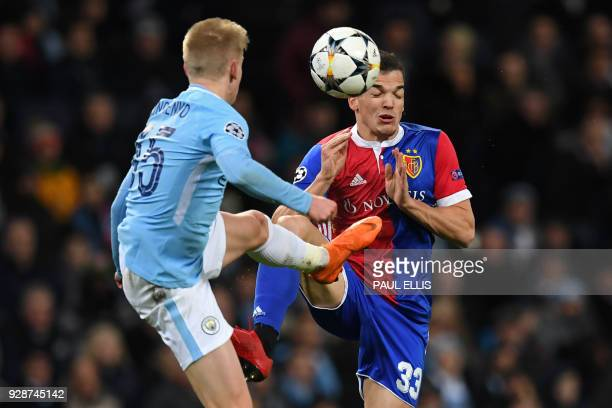 Manchester City's Ukrainian midfielder Oleksandr Zinchenko vies with Basel's Spanish midfielder Kevin Bua during the UEFA Champions League round of...