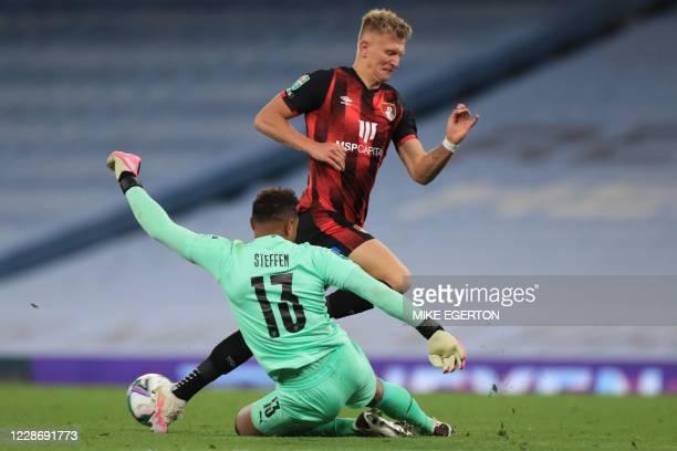 Manchester City's U.S. Goalkeeper Zack Steffen challenges Bournemouth's English striker Sam Surridge during the English League Cup third round...