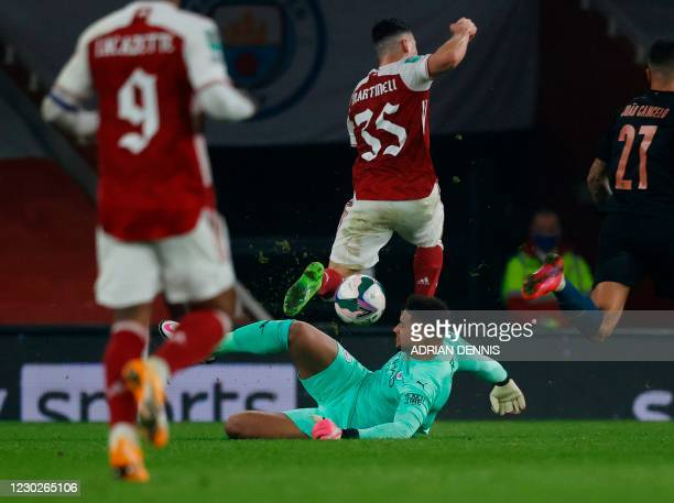 Manchester City's U.S. Goalkeeper Zack Steffen makes contact with Arsenal's Brazilian striker Gabriel Martinelli during the English League Cup...