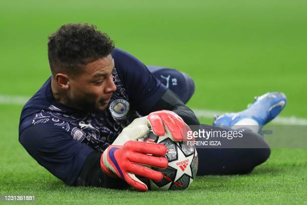 Manchester City's US goalkeeper Zack Steffen warms up prior to the UEFA Champions League, last 16, 1st-leg football match Borussia Moenchengladbach v...