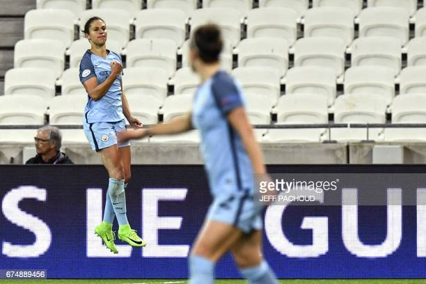 Manchester City's US midfielder Carli Lloyd celebrates after scoring a goal during the UEFA Women's Champions League semifinal football match between...