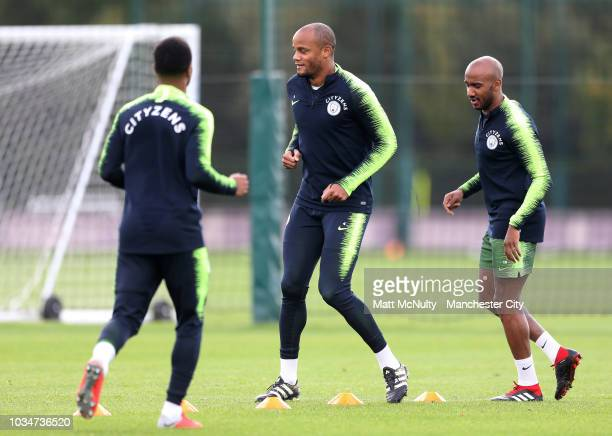 Manchester City's Vincent Kompany and Fabian Delph during training at Manchester City Football Academy on September 17 2018 in Manchester England