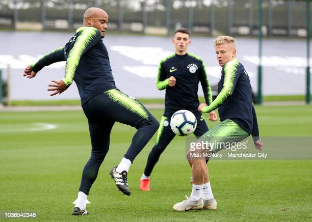 Manchester City's Vincent Kompany and Oleksandr Zinchenko during training at Manchester City Football Academy on September 20 2018 in Manchester...