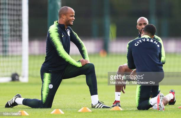 Manchester City's Vincent Kompany and teammates stretch during training at Manchester City Football Academy on September 17 2018 in Manchester England