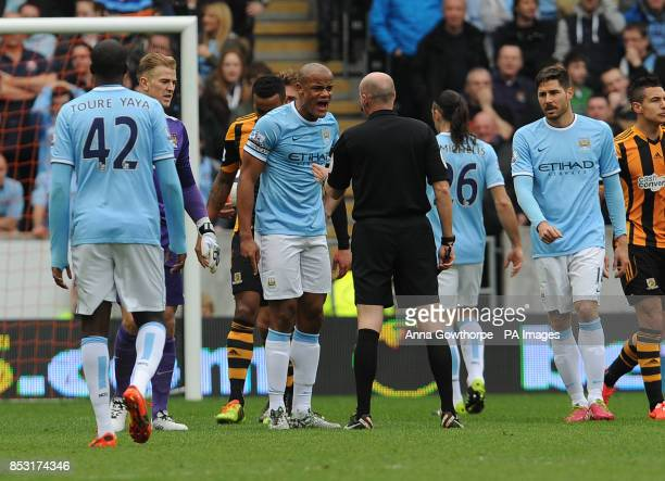 Manchester City's Vincent Kompany argues with referee Lee Mason after being sent off during the Barclays Premier League match at the KC Stadium Hull