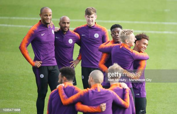 Manchester City's Vincent Kompany Fabian Delph and John Stones during training at Manchester City Football Academy on September 18 2018 in Manchester...