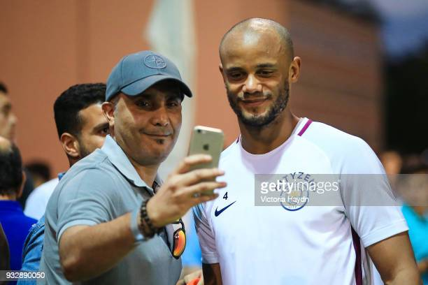 Manchester City's Vincent Kompany interacts with fans during the training session on March 16 2018 in Abu Dhabi United Arab Emirates
