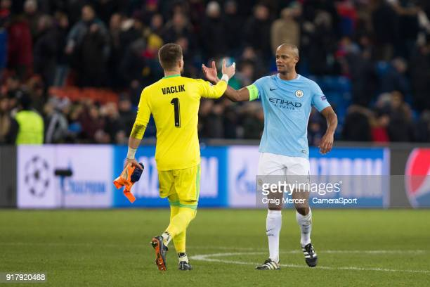 Manchester City's Vincent Kompany shakes hands with Basel's Tomas Vaclik at full time during the UEFA Champions League Round of 16 First Leg match...