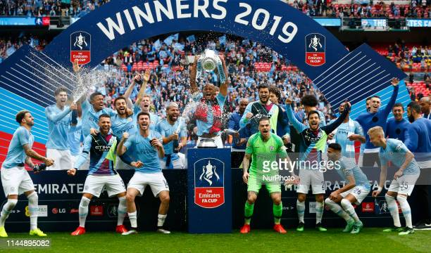 Manchester City's Vincent Kompany with Trophy during FA Cup Final match between Manchester City and Watford at Wembley stadium, London on 18 May 2019,