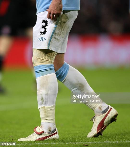 Manchester City's Wayne Bridge has his knee strapped up after getting a knock