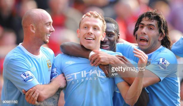 Manchester City's Welsh forward Craig Bellamy celebrates with team mates after scoring the third goal during the English Premier League football...