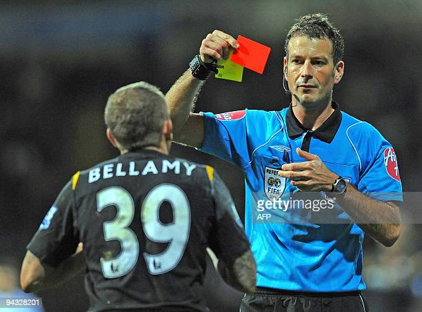 Manchester City's Welsh forward Craig Bellamy is sent off by referee Mark Clattenburg during the English Premier League football match between Bolton...