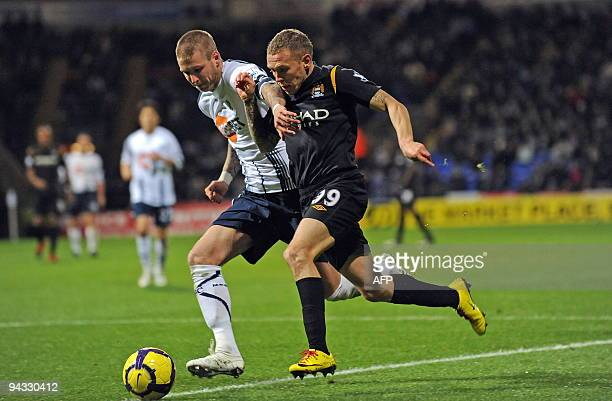 Manchester City's Welsh forward Craig Bellamy vies with Bolton Wanderers' Icelandic defender Gretar Steinsson during the English Premier League...
