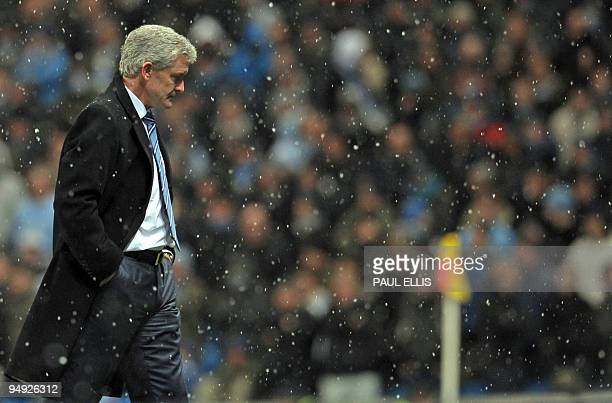 Manchester City's Welsh manager Mark Hughes in the snow during the English Premier League football match between Manchester City and Sunderland at...