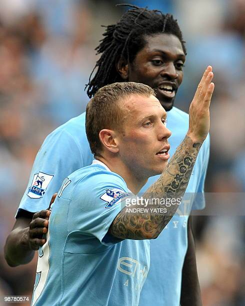 Manchester City's Welsh player Craig Bellamy celebrates with Togolese striker Emmanuel Adebayor after scoring his side's third goal with during the...
