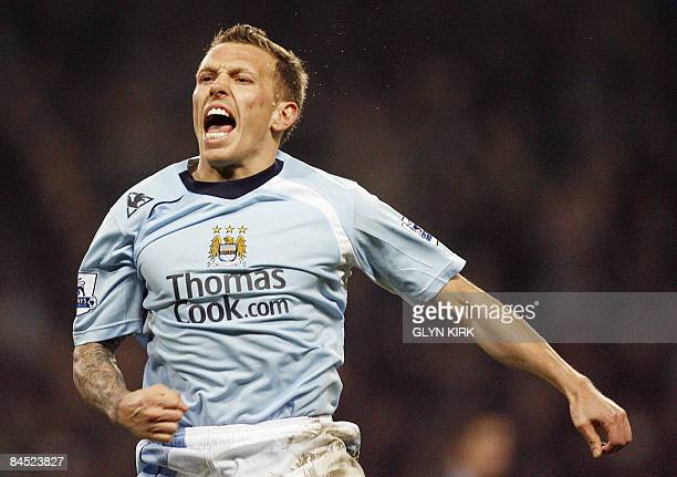 Manchester City's Welsh Striker Craig Bellamy celebrates scoring a goal during their Premier League football match against Newcastle at the City Of...