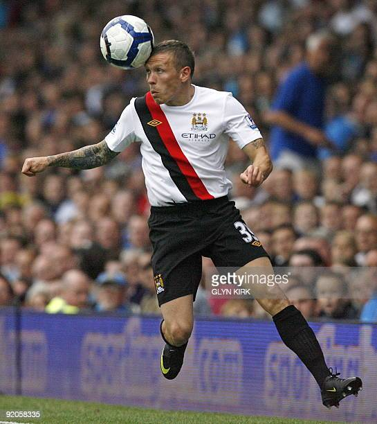 Manchester City's Welsh striker Craig Bellamy in action during their Premier League football match against Portsmouth at Fratton Park in Portsmouth,...