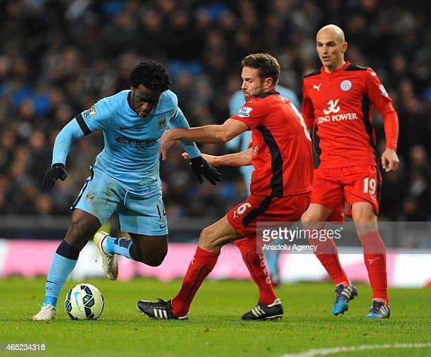 Manchester City's Wilfried Bony twists around Leicester City defender Matthew Upson during the Premier League match between Manchester City and...