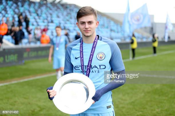 Manchester City's Will Patching celebrates winning the U18 Northern Premier League trophy