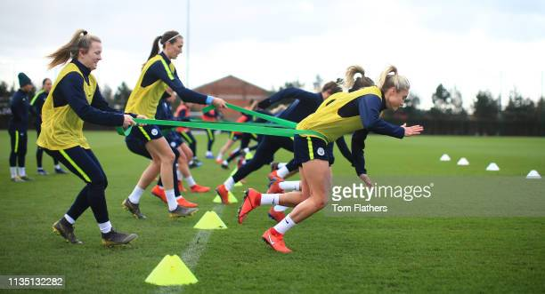 Manchester City's Women's team Lauren Hemp and Steph Houghton in action during training at Manchester City Football Academy on March 11 2019 in...