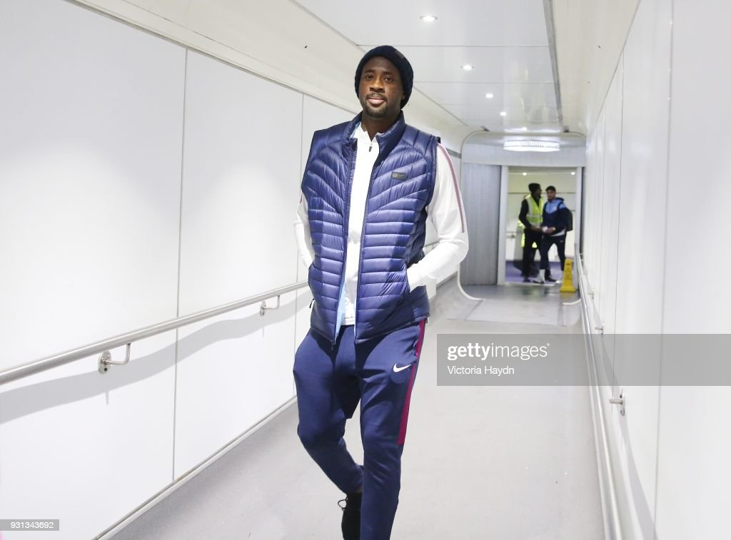 Manchester City's Yaya Toure boards the flight at Manchester Airport on March 13, 2018 in Manchester, England.