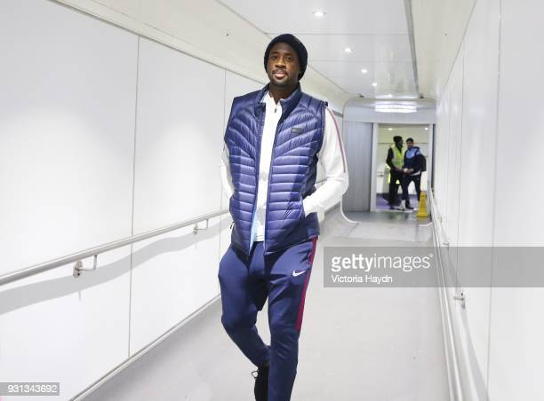 Manchester City's Yaya Toure boards the flight at Manchester Airport on March 13 2018 in Manchester England