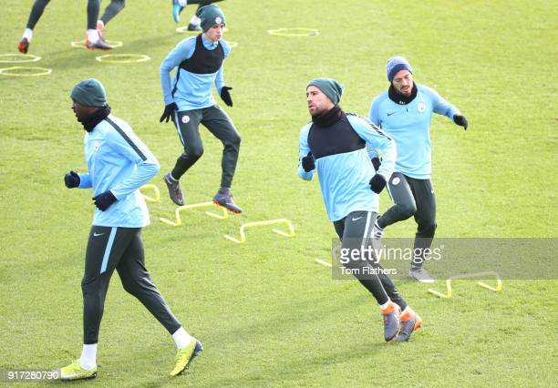 Manchester City's Yaya Toure Nicholas Otamendi David Silva and Phil Foden in action during training at City Football Academy on February 12 2018 in...