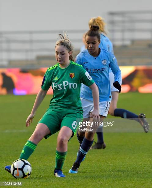 Manchester England 03rd February Watfords Alysha StojkoDown is chased by Nikita Parris during the SSE Women's FA Cup fourth round football match...