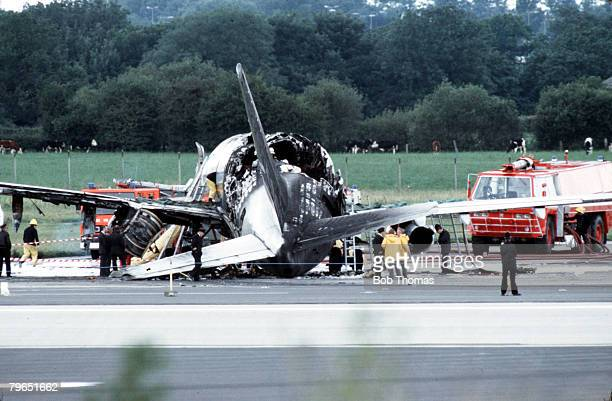 Manchester, England, 22nd August 1985, The burnt out fuselage of a Boeing 737 aeroplane lies on the runway of Ringway Airport after crashing at...