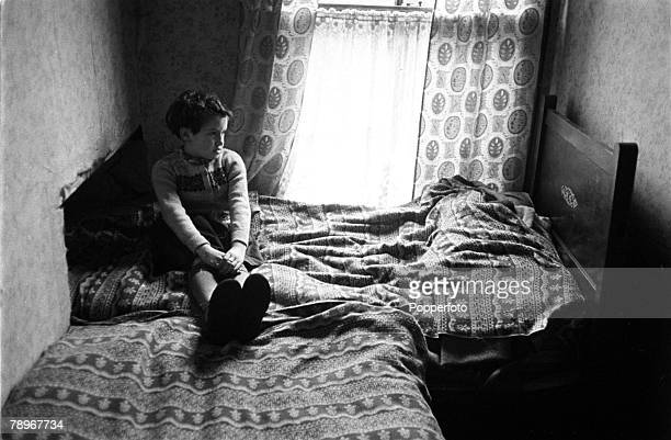 Manchester England A young child is pictured in the bedroom of his home in the slums of Salford