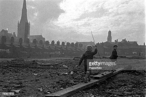 Manchester, England Two children are pictured playing in the slums of Salford