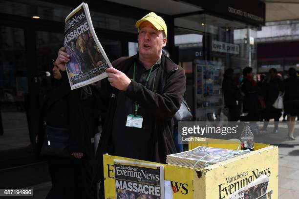 Manchester Evening News vendor sells newspapers showing headlines from the terrorist attack on May 23 2017 in Manchester England Prime Minister...