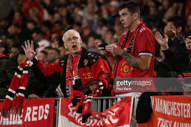 Manchester fan celebrates the fourth goal during a preseason friendly match between Manchester United and Leeds United at Optus Stadium on July 17...