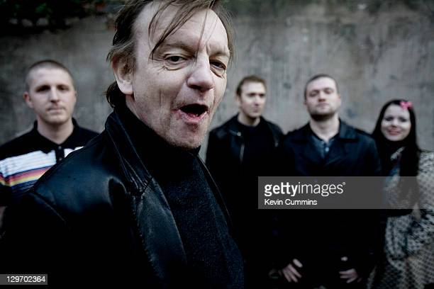 Manchester musician Mark E Smith poses with other members of The Fall Salford Manchester 18th March 2011
