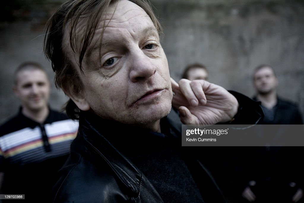 Manchester musician Mark E Smith poses with other members of The Fall behind, Salford, Manchester, 18th March 2011.