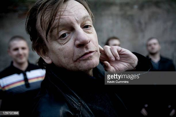 Manchester musician Mark E Smith poses with other members of The Fall behind Salford Manchester 18th March 2011