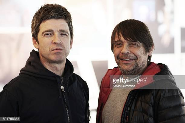 Manchester musicians Noel Gallagher and Mani pictured together at the Adidas Spezial exhibition Dale Street Manchester 1st November 2014