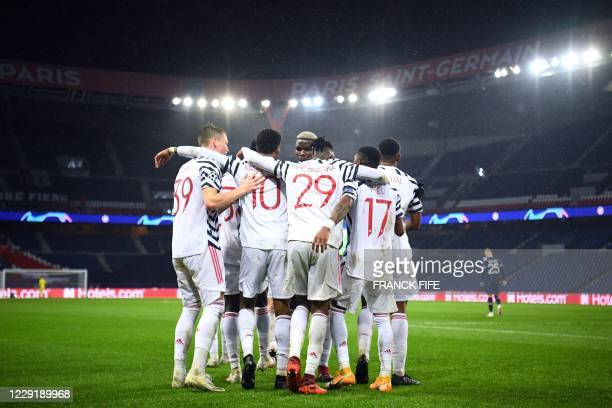 Manchester players celebrate their second goal during the UEFA Champions League Group H first-leg football match between Paris Saint-Germain and...