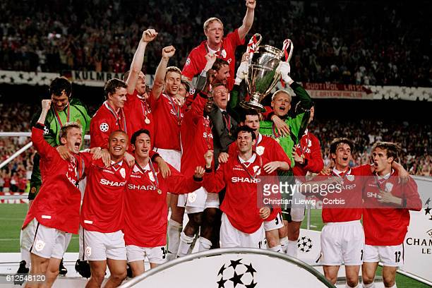 Manchester players celebrate with trophy after winning the 19971998 UEFA Champions League against Bayern Munich   Location Barcelona Spain
