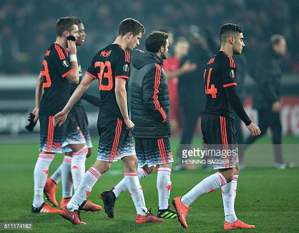 Manchester players leave after the UEFA Europa League Round of 32 football match between Manchester United and FC Midtjylland in Hernin on February...