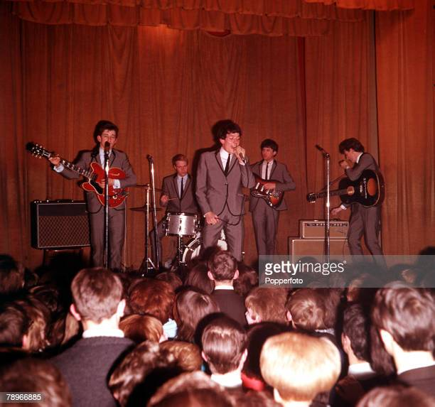 1964 Manchester pop band 'The Hollies' in live action before an enthusiastic audience made up of their fans