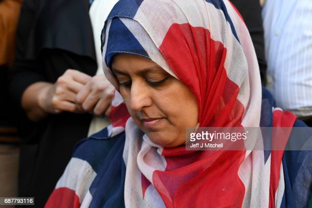 Manchester resident Gulnar Bano Kham Ghadri wears a Union flag head scarf during a vigil by multicultural religious leaders from across Manchester in...