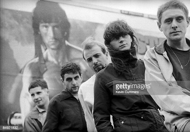 Manchester rock band Happy Mondays in front of a poster of Sylvester Stallone as Rambo 2nd September 1985 Left to right Gary Whelan Paul Ryder Mark...