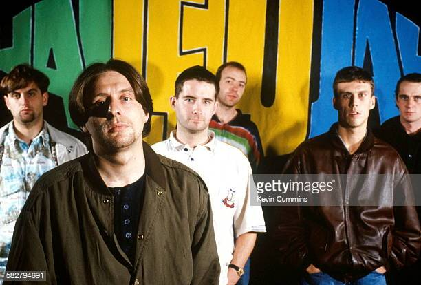 Manchester rock band Happy Mondays in front of artwork for their EP 'Hallelujah', 31st October 1989. Left to right: Paul Ryder, Shaun Ryder, Paul...