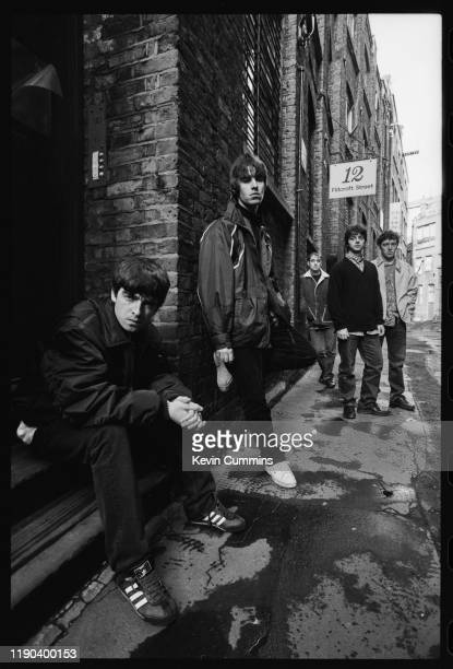 Manchester rock band Oasis outside 12 Flitcroft Street in Soho, London, 17th March 1994; guitarist Noel Gallagher, singer Liam Gallagher, bassist...