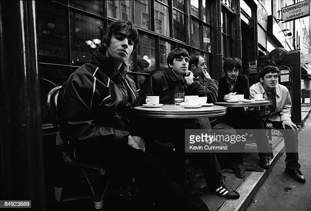 Manchester rock band Oasis outside a cafe in Frith Street London 17th March 1994 Left to right singer Liam Gallagher guitarist Noel Gallagher rhythm...