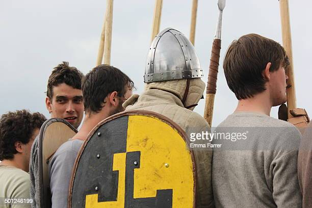 Men from Historia Normannis 12th century battle reenactment group in chain mail armour taking part in a battle at Prestwich Carnival in North...