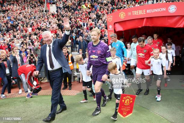 Manchester United '99 Legends Manager Sir Alex Ferguson leads out the teams prior to the 20 Years Treble Reunion match between Manchester United '99...