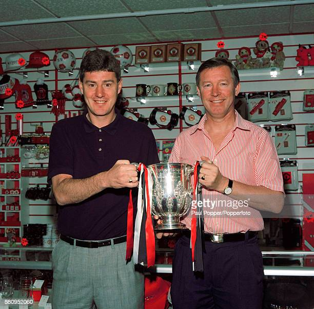 Manchester United Alex Ferguson holding the League Cup with his assistant Brian Kidd at Old Trafford circa August 1992